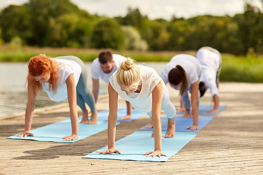 group-of-people-making-yoga-exercises-ou