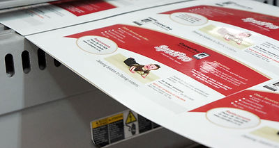 Book covers being laminated