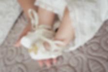 Baby feet in mommy's hand. Christening.