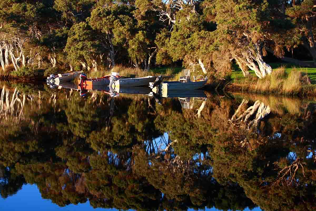 Boat reflections at town jetty