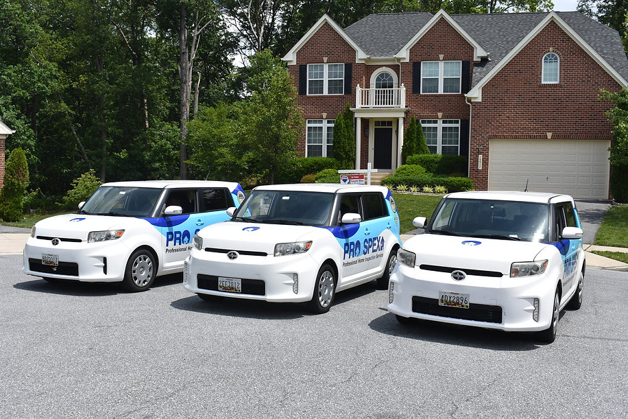 3 white Toyota scions with the Pro-Spex logo on the side in front of a single family home