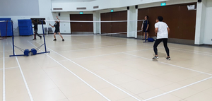Participants battling for a point as other watch on in anticipation.