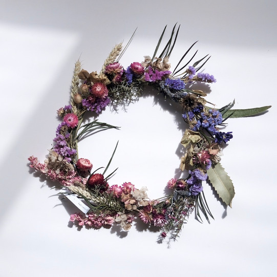 Pink and purple dried flower wreath