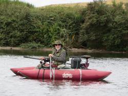 Maurice on pontoon with motor Lake Kuratau Dec 2014.jpg
