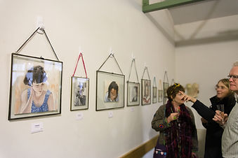 Portraits exhibition in the lecture hall of Wells Museum
