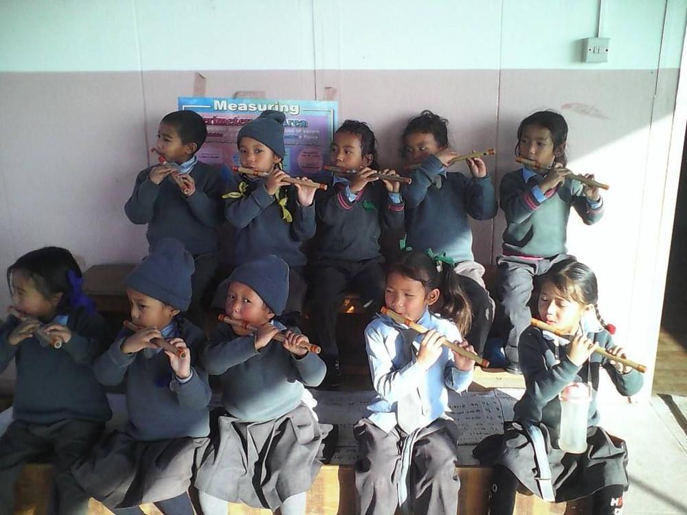 Children playing their new instruments