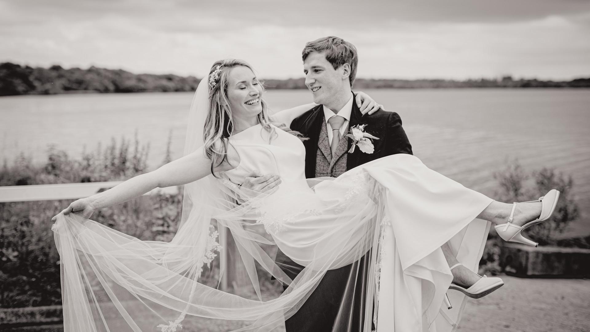 Groom Holding Wife   Northern Ireland Wedding   Living Witness Weddings