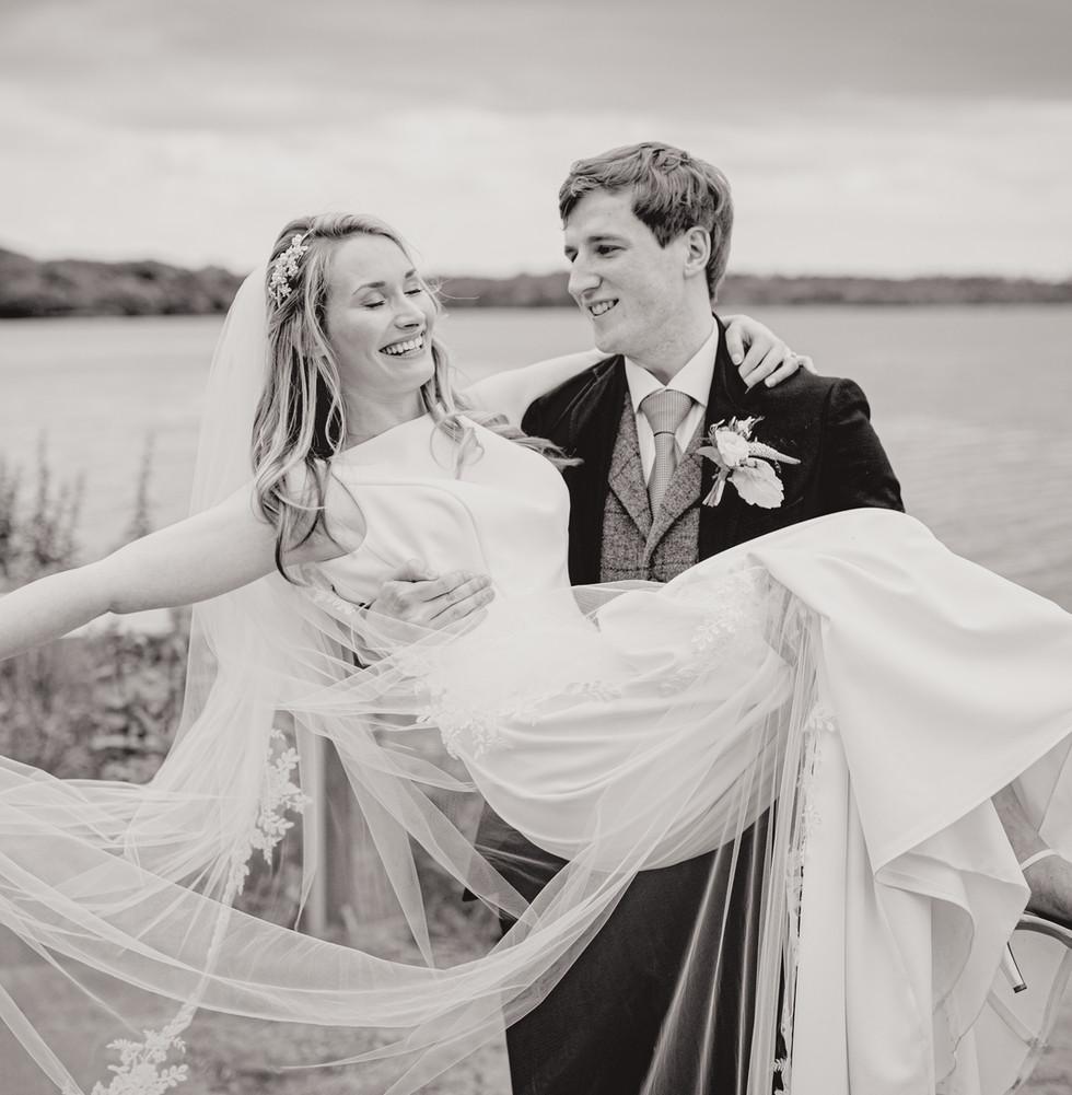 Groom Holding Wife | Northern Ireland Wedding | Living Witness Weddings
