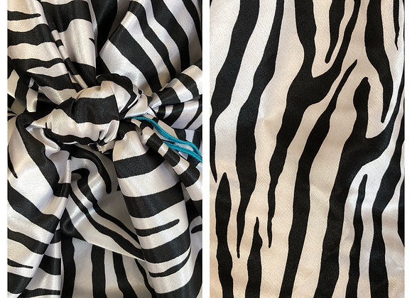 WHITE AND BLACK ZEBRA PRINT WITH BLACK EDGING