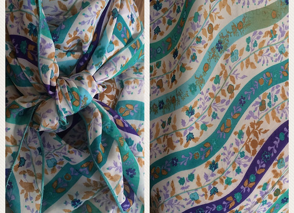 WHITE WITH TEAL AND PURPLE WAVY LINES FLORAL