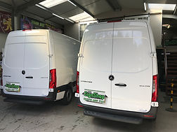 Vans waiting to be sign written.JPG