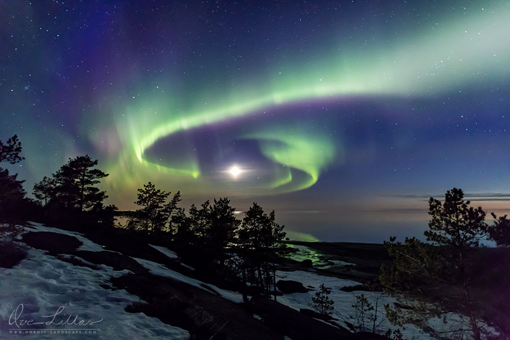 Landscape at night with Northern Lights and the moon