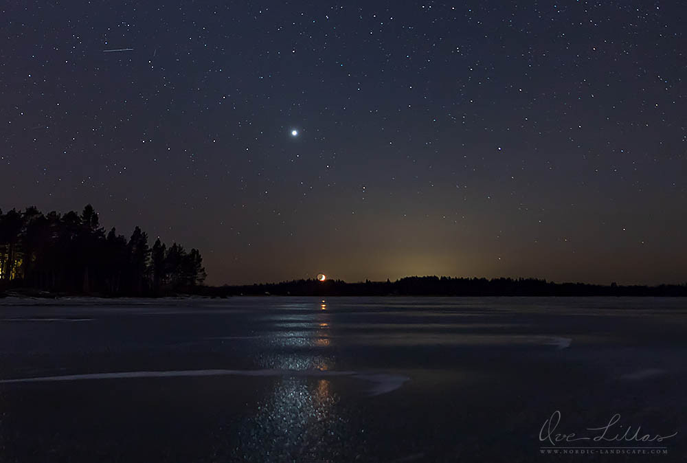 The moon and Venus reflecting in the ice