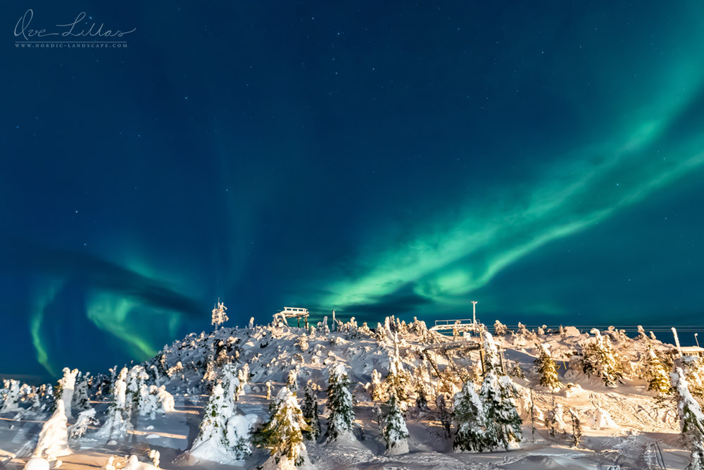 Northern Lights over hilltop in northern Finland