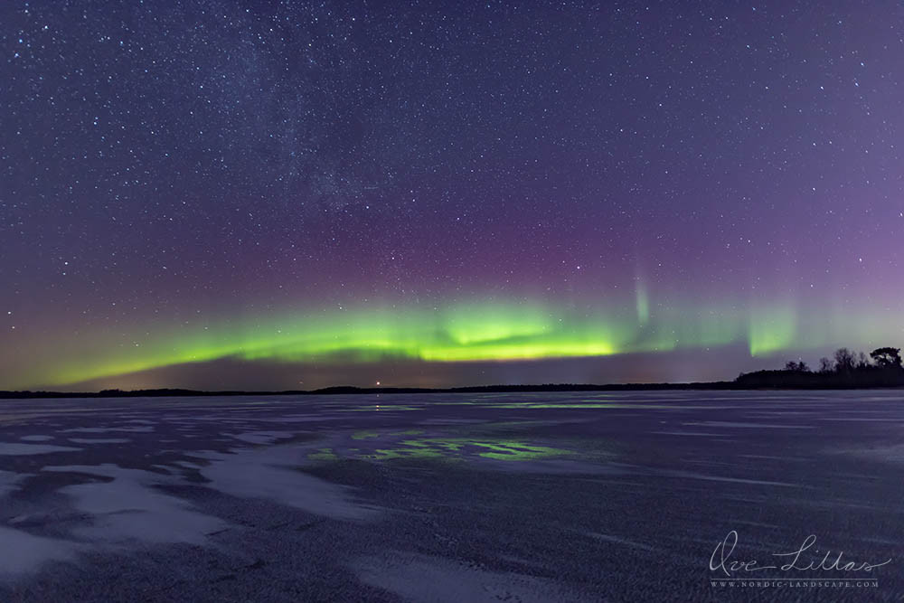 Northern Lights, Aurora Borealis, reflecting in the ice