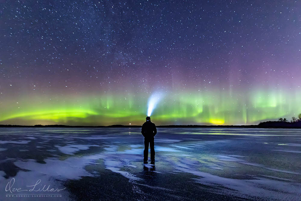 Me standing on the ice and watching the Northern Lights dancing