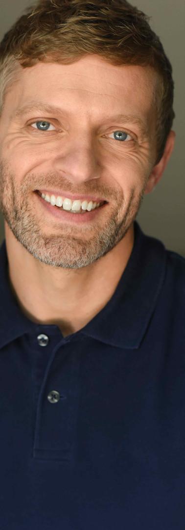 Troy Donavan Headshot 2b Reduced.jpg