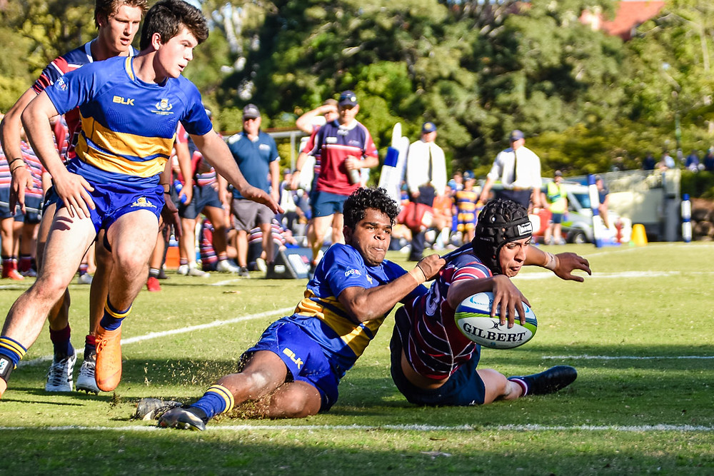 Dion Samuela scores one of his two tries for The Southport School against Toowoomba Grammar School