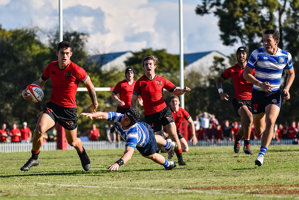Mayson Hill of Gregory Terrace beats the tackle of Daniel Atkinson of Nudgee College