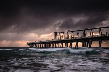Sand pumping pier