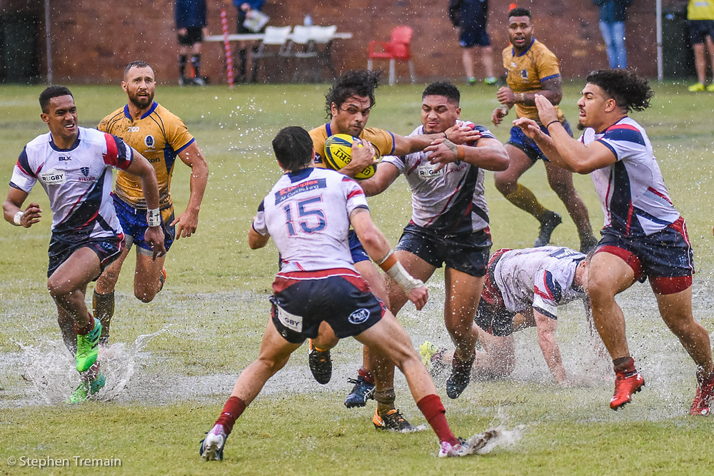 Karmichael Hunt hits the ball up for Brisbane City against Melbourne Rising, with Quade Cooper and Samu Kerevi in support