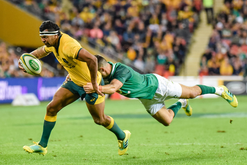Kurtley Beale is tackled by an Irish defender