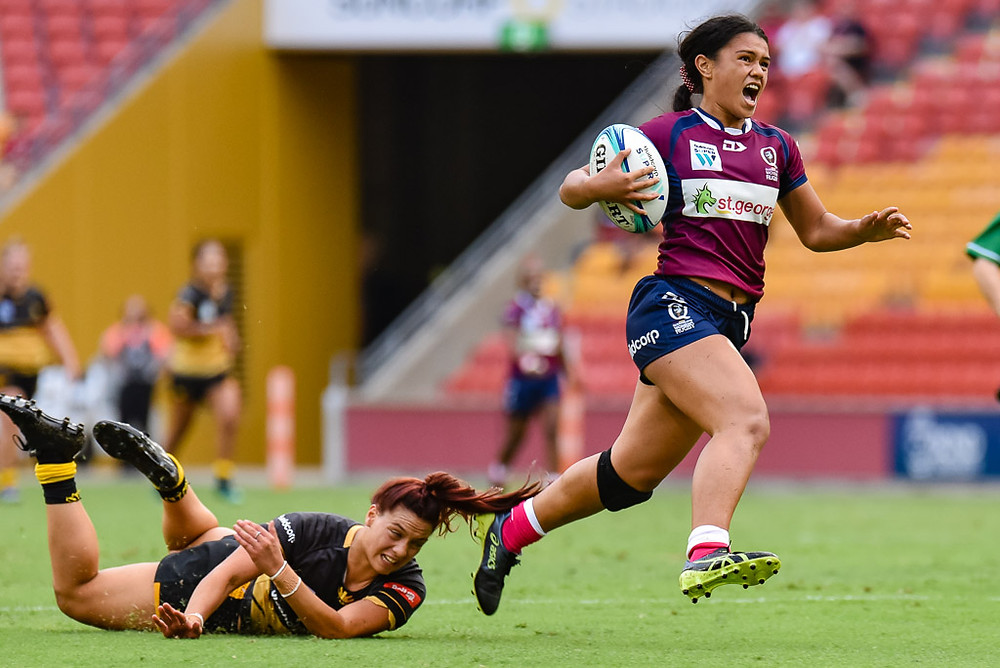 Alysia Lefau-Fakaosilea beats the tackle of Zakiya Kereopa to score for Queensland Women's XV