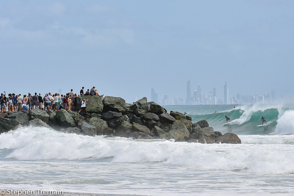 Spectators watching surfers off Kirra Point during the huge swell produced by Cyclone Oma