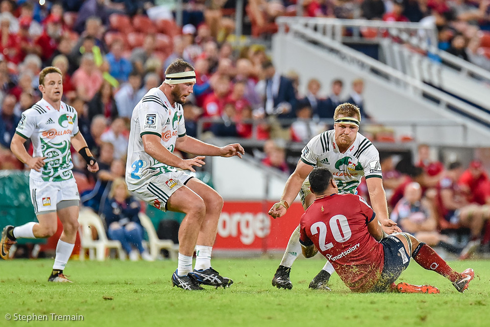 George Smith dives on a loose ball, as Sam Cane wraps him up