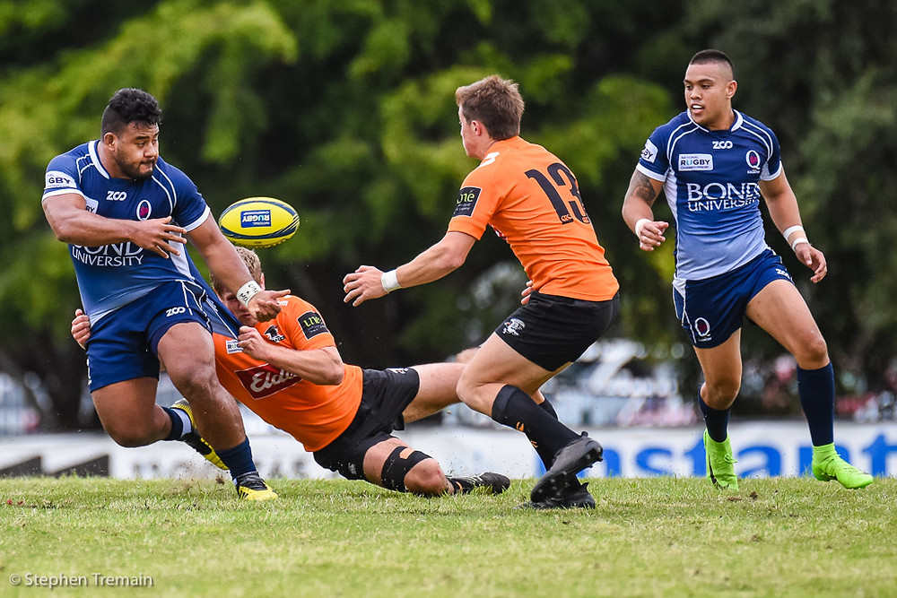 Taniela Tupou offloads to Duncan Paia'aua. QLD Country v NSW Country