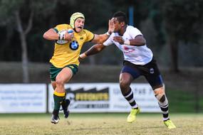Clay Uyen of Australia fends a Fijian player at 2017 U20 Oceania Cup at Bond University