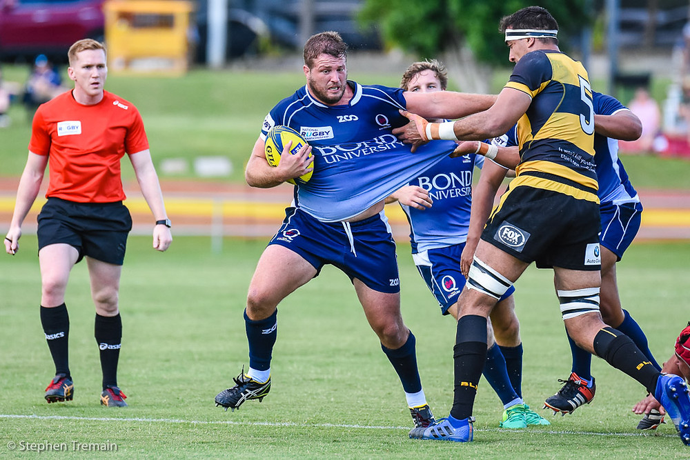 James Slipper fends off a tackle from Richie Arnold. QLD Country v Perth Spirit