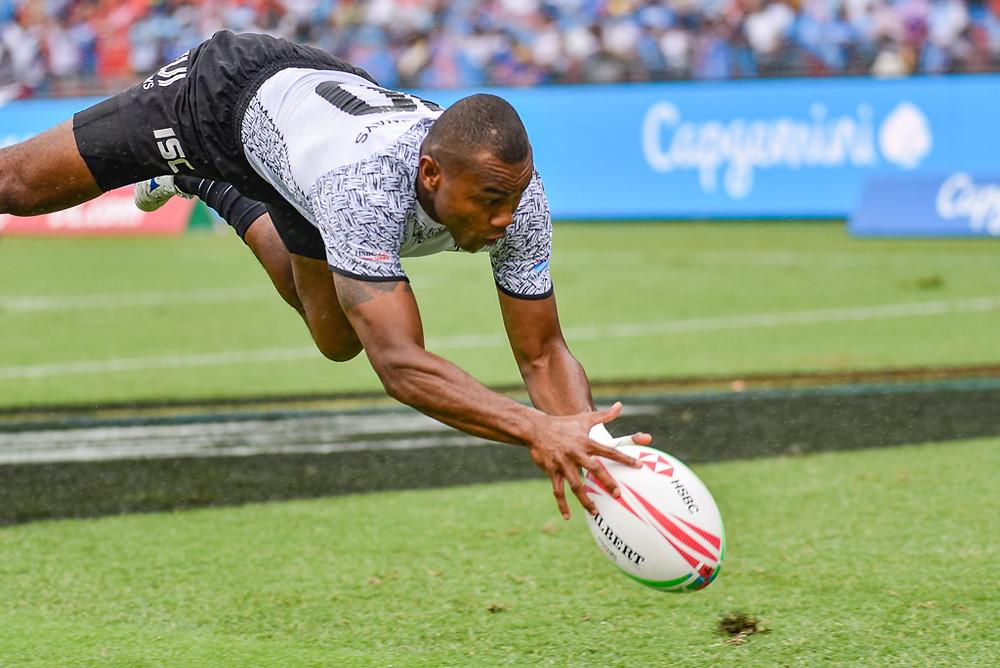 Fiji's Alasio Naduva scores a try against Japan