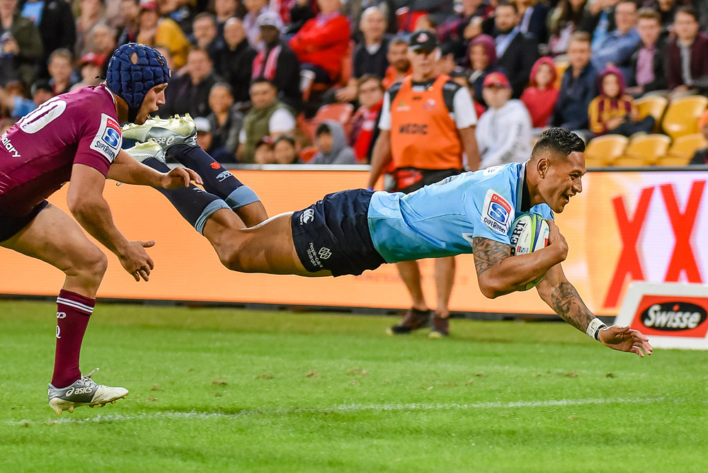 Israel Folau dives over for a try for the NSW Waratahs against the Queensland Reds