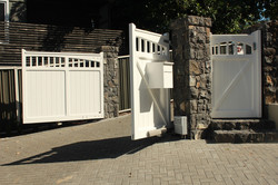 automatic gates and stone walls