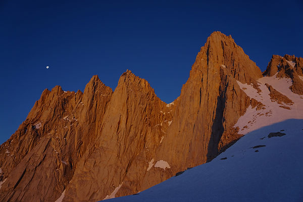 Upward view of ragged mountain rocks