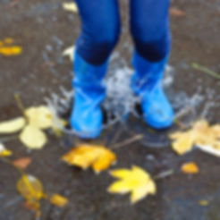 Girl with blue rubber boots jumping.jpg