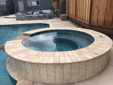 Spa with travertine coping
