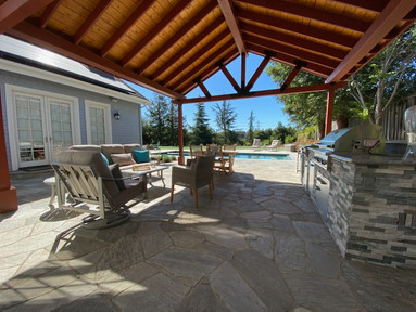Solid roof pergola & outdoor kitchen