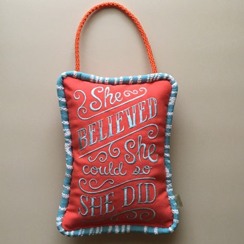 """She Believed She Could"" Door Pillow"