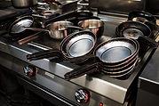 metal-black-pans-on-restaurant-kitchen-P