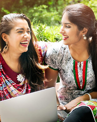 girl-friends-laptop-happy-outdoors-conce