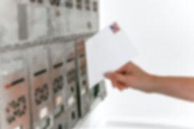 person-holding-white-envelope-1550334.jp