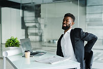young-businessman-office-desk-suffering-
