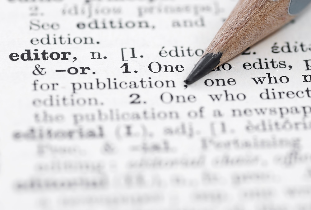 Dictionary definition of editor and a sharpened pencil