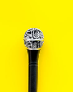 black microphone against yellow background