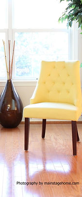 Home staging yellow chair and brown vase