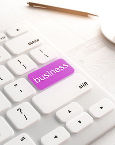 white computer keyboard with purple business button