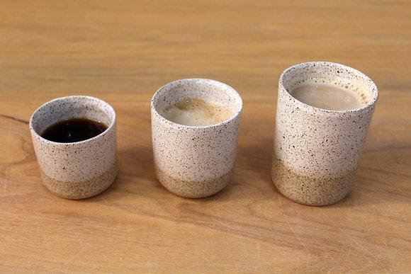 Copo de cappuccino Areia