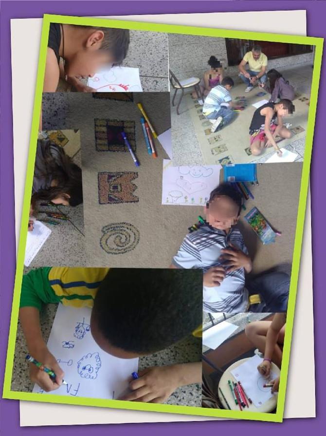 Crianças da Amamos desenhando